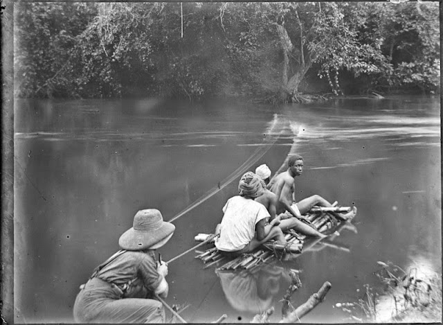 Crossing a river by raft. E.O. Teale Collection