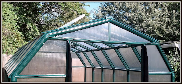 Greenhouse with skylight and weather stripping