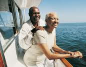 African American couple relaxing on a boat