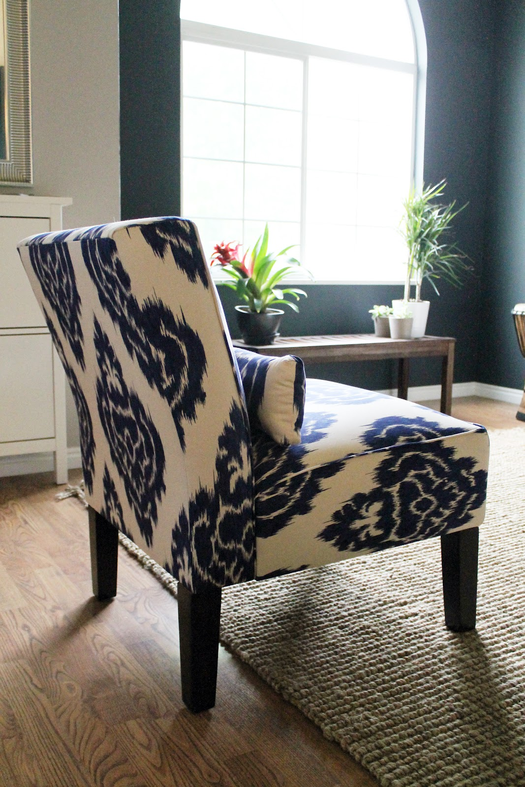 i have always loved this ikat slipper chair and thought the cream and navy would go so well with our new darker digs i snagged it when it was for sale on