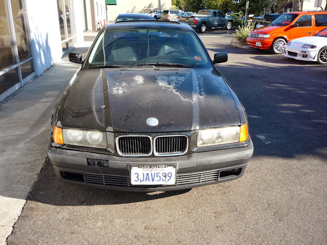 1994 BMW 325iS with peeling paint before repairs at Almost Everything Auto Body