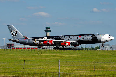 AirAsia X Airbus A340-300 9M-XAC in special Oakland Raiders livery arriving at London Stansted airport from Kuala Lumpur, Malaysia