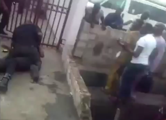 Photos: Two policemen fight in public  1