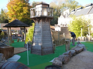 Richard Gottfried playing the 7th hole at Pirate Island Adventure Golf at Wookey Hole