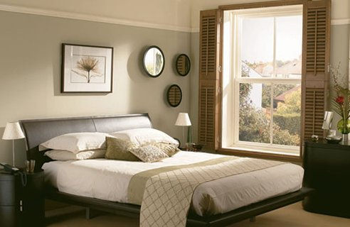 another simple bedroom design with a walk in closet and bathroom