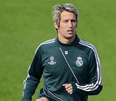 Coentrao training with Real Madrid green jersey