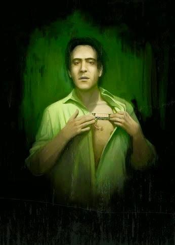 imagen de un hombre con la camisa un poco abierta mostrando su pecho donde se ve incrustado un dispositivo como un panel.