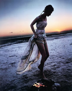 photo of Kate moss walking by the sea taken by Corine Day