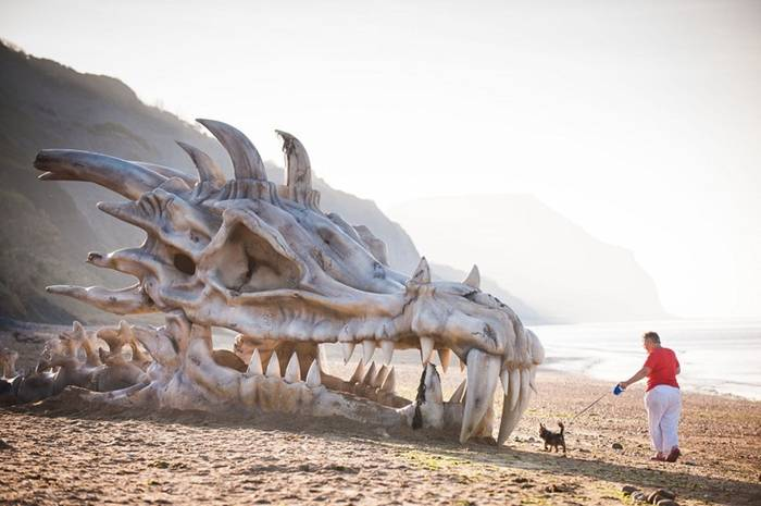 A giant skull of a dragon on Charmouth beach in Dorset's Jurassic coast in England. The spectacular skull the size of a bus appeared to have been washed up on the beach famous for its treasure trove of dinosaur fossils. No need to panic. It's just a publicity stunt by U.K. streaming video service Blinkbox who knows exactly how to celebrate the arrival of season 3 of the TV series Game of Thrones on their service.