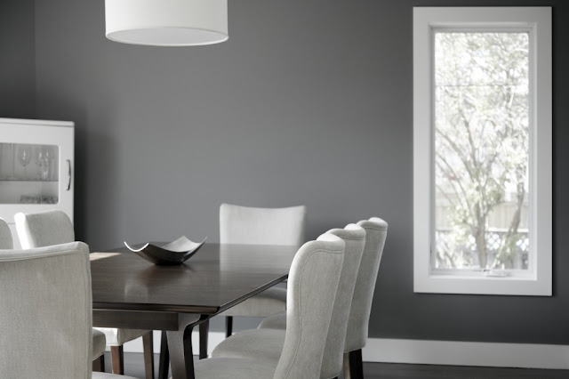 Picture of dark brown minimalist dining table with light grey chairs in the dining room