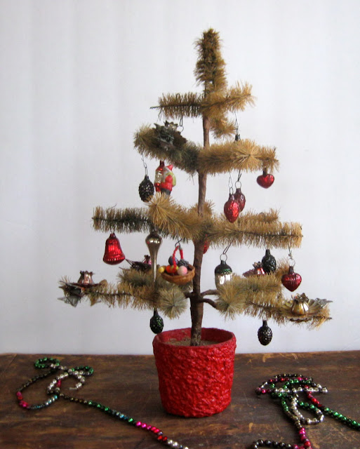 Anything goes here a most unusual bottle brush tree spun for Bottle brush christmas tree decorations