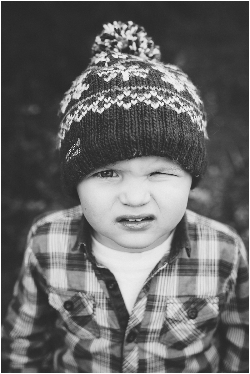 Black & white portrait of a little boy in a bobble hat
