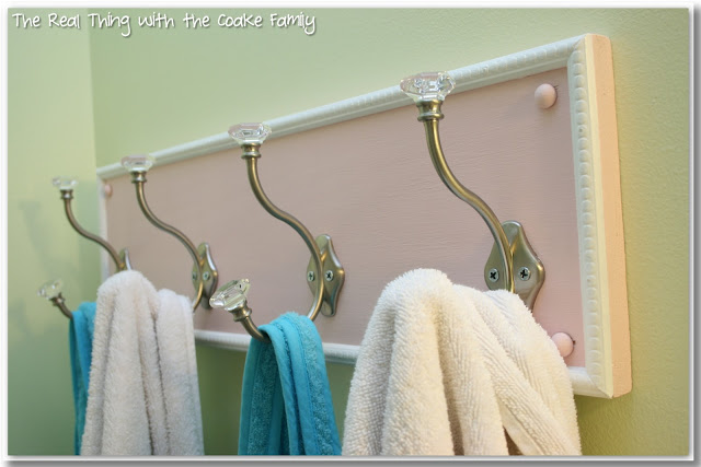 This DIY bathroom towel rack is so inexpensive and easy to make. It will look great in my bathroom or entry hallway and help keep us organized along with maximizing our hanging space.