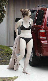 Julianne Moore caught in her driveway in li'l, black bikini and a towel
