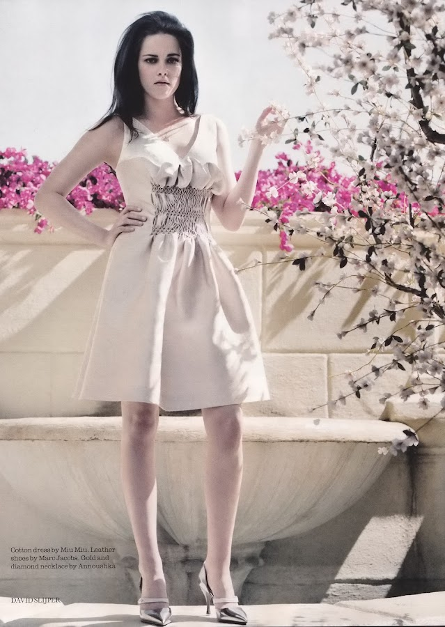 Kristen Stewart in cotton dress and beautiful pink flowers in the backgroud