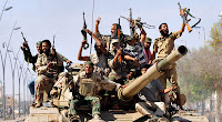 Libyan government fighters celebrated after routing the last remaining forces loyal to Col. Muammar el-Qaddafi.