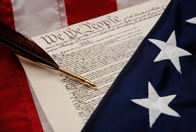 Picture of an American Flag. U.S. Constitution and old-fashioned pen