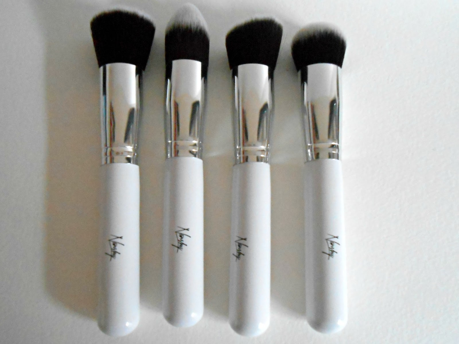 elf pointed foundation brush. the set contains four brushes, a flat top buffer brush, pointed foundation angled brush and round brush. elf