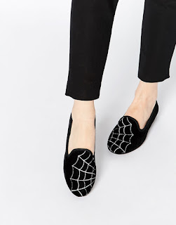 http://www.asos.com/ASOS/ASOS-LEGACY-Halloween-Cobweb-Slippers/Prod/pgeproduct.aspx?iid=5520355&cid=4172&sh=0&pge=4&pgesize=36&sort=-1&clr=Black&totalstyles=2110&gridsize=3