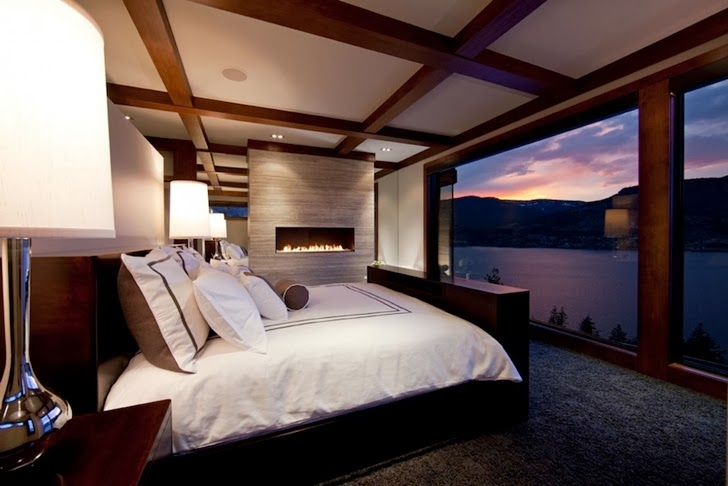 Bedroom in Contemporary style lake house in Canada
