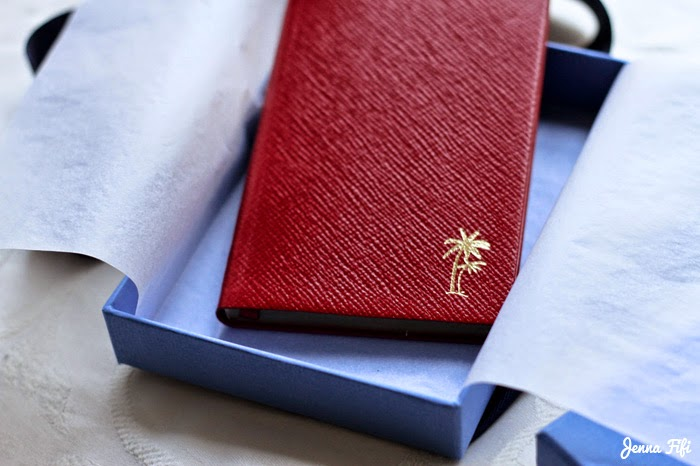 Red leather smythson panama notebook with gold palm tree's