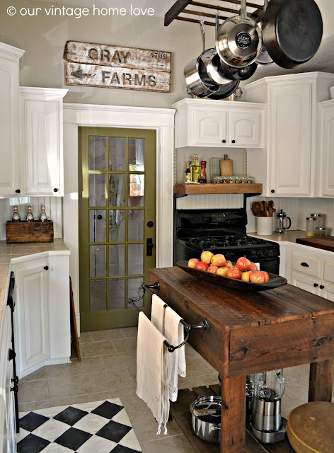 The modern cabinets paired with the farmhouse cooking island gives this kitchen a cozy feel
