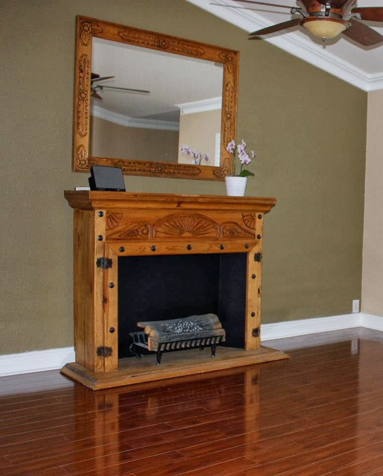 http://firefinishblog.com/2014/02/16/fireplace-makeover/