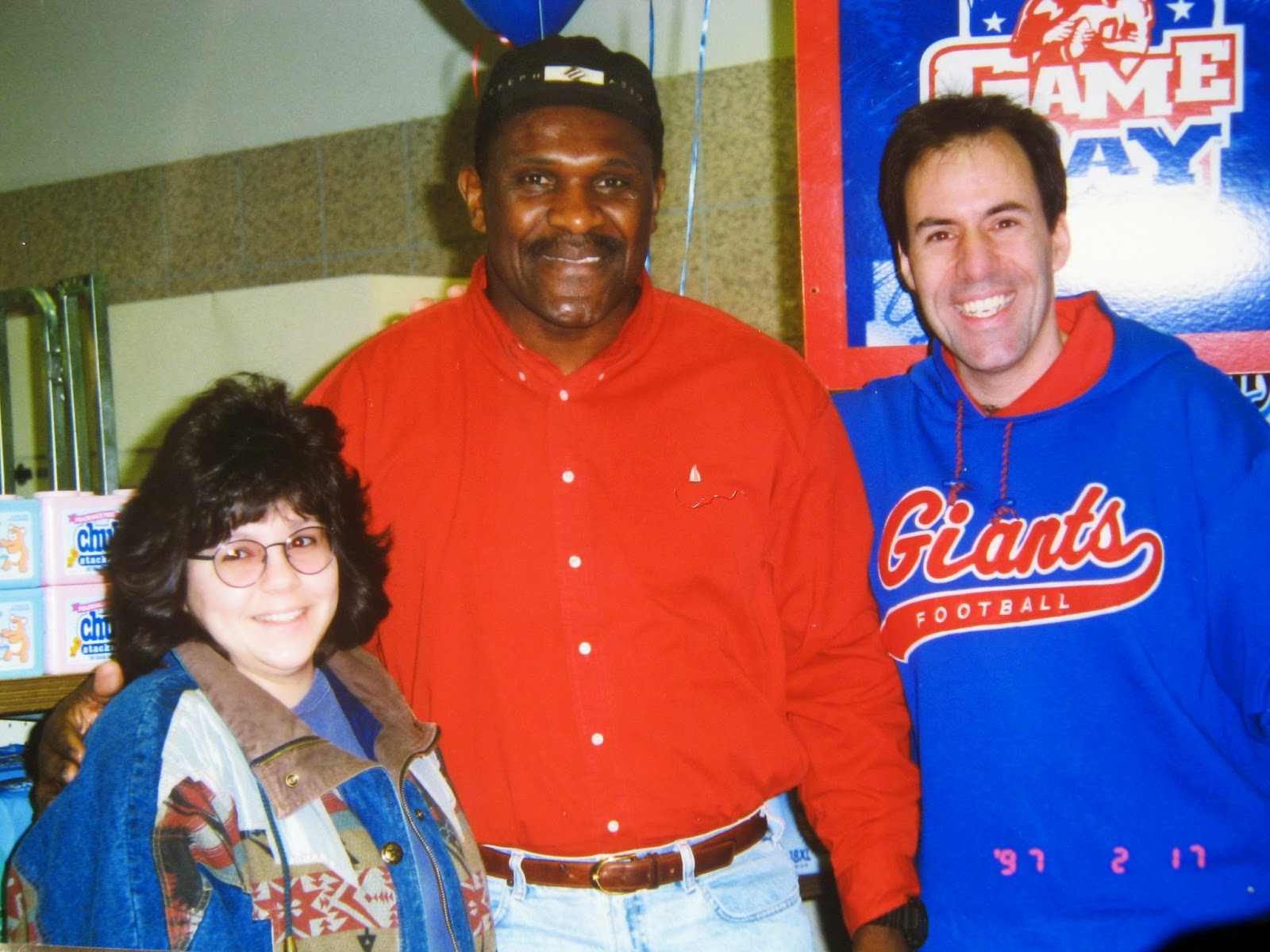 Tommy & Lynn with Harry Carson. Harry's hand is almost as big as Lynn's head... he was huge! Awesome!