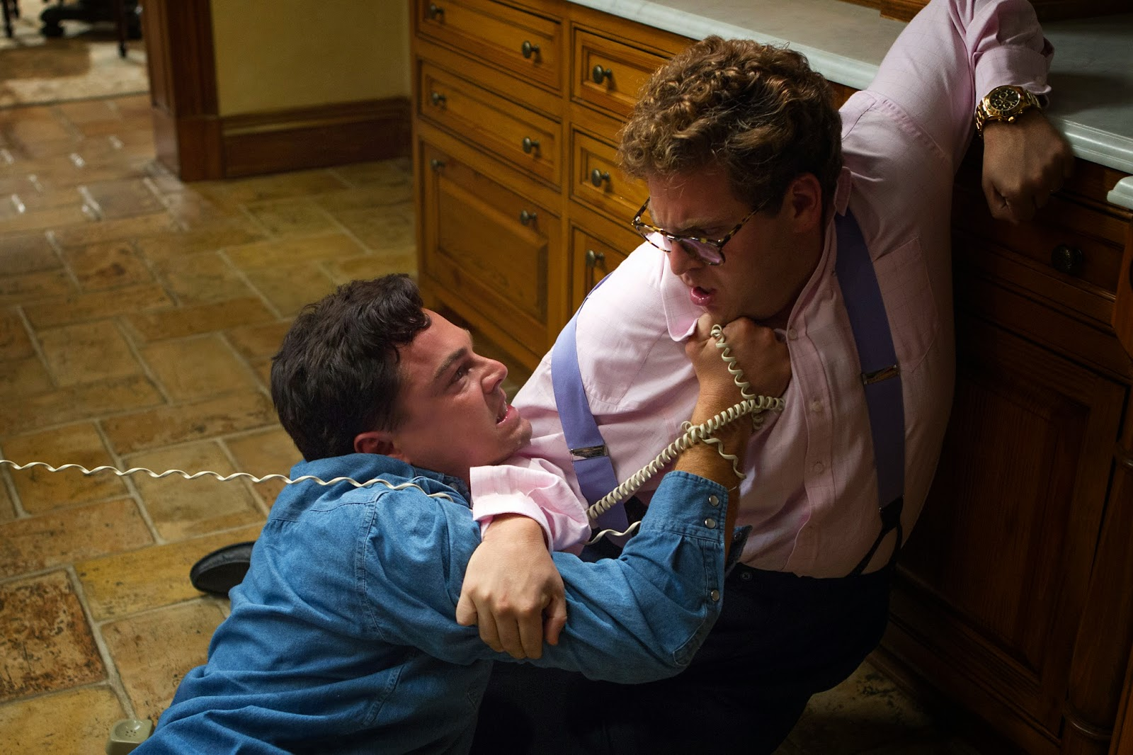 The wolf of wall street review reviews from a bed jordan belfort leonardo dicaprio is adamant about getting donnie azoff jonah hill off the phone amipublicfo Image collections