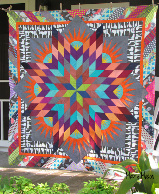 Summer Solstice quilt top with a border with Attitude