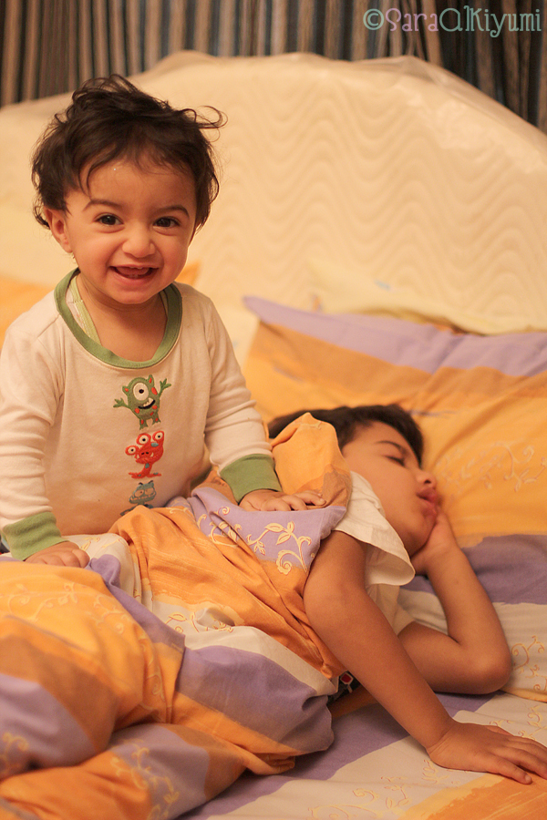 kids sleeping on mommy's bed