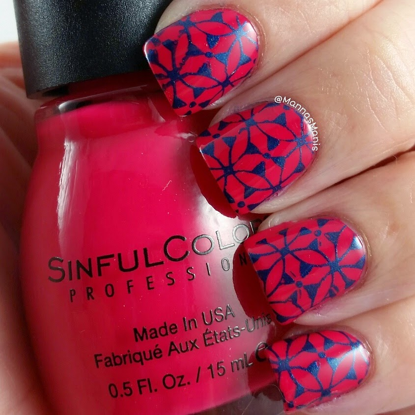 red nail polish with blue nail stamping