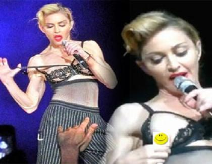 Madonna takes off bra on the stage