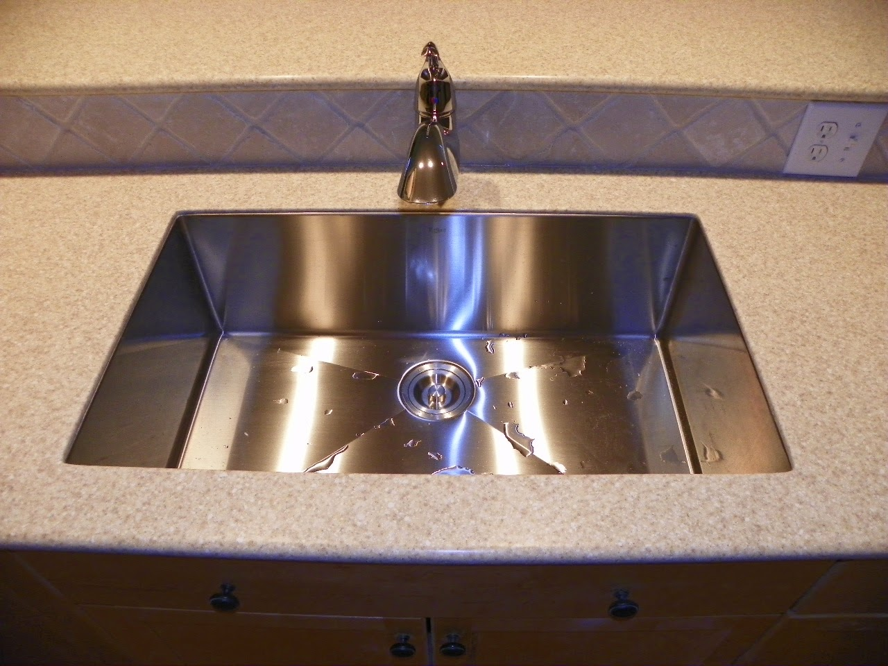The solid surface and stone countertop repair blog replacing a corian 850 sink with an for Replace undermount bathroom sink