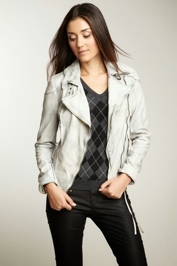 Half white jacket with black sweater and pents