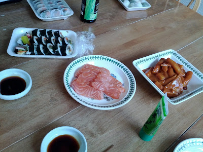gimbap, dduk bokki, and salmon sashimi