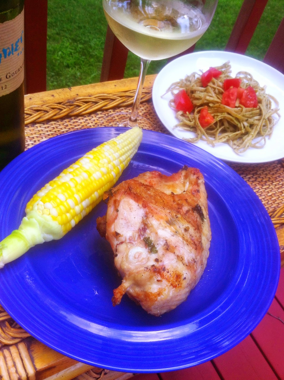 Simply Scrumptious Bone-In Grilled Chicken Breasts with side of corn, linguine and a Viogner.