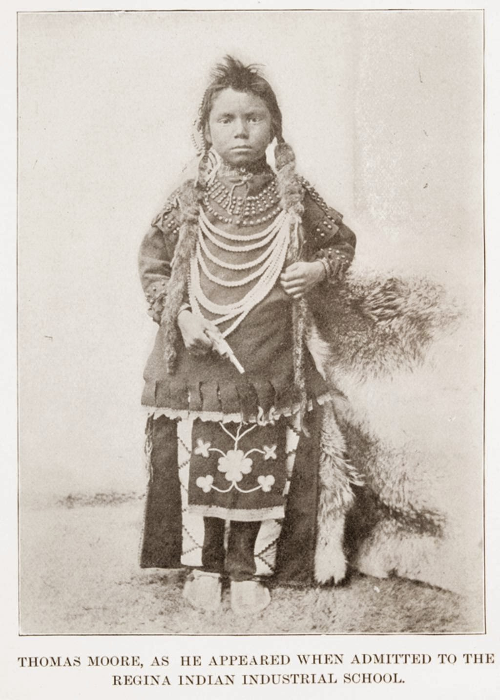 Young Thomas Moore before entering residential school in full First Nations clothing and accessories
