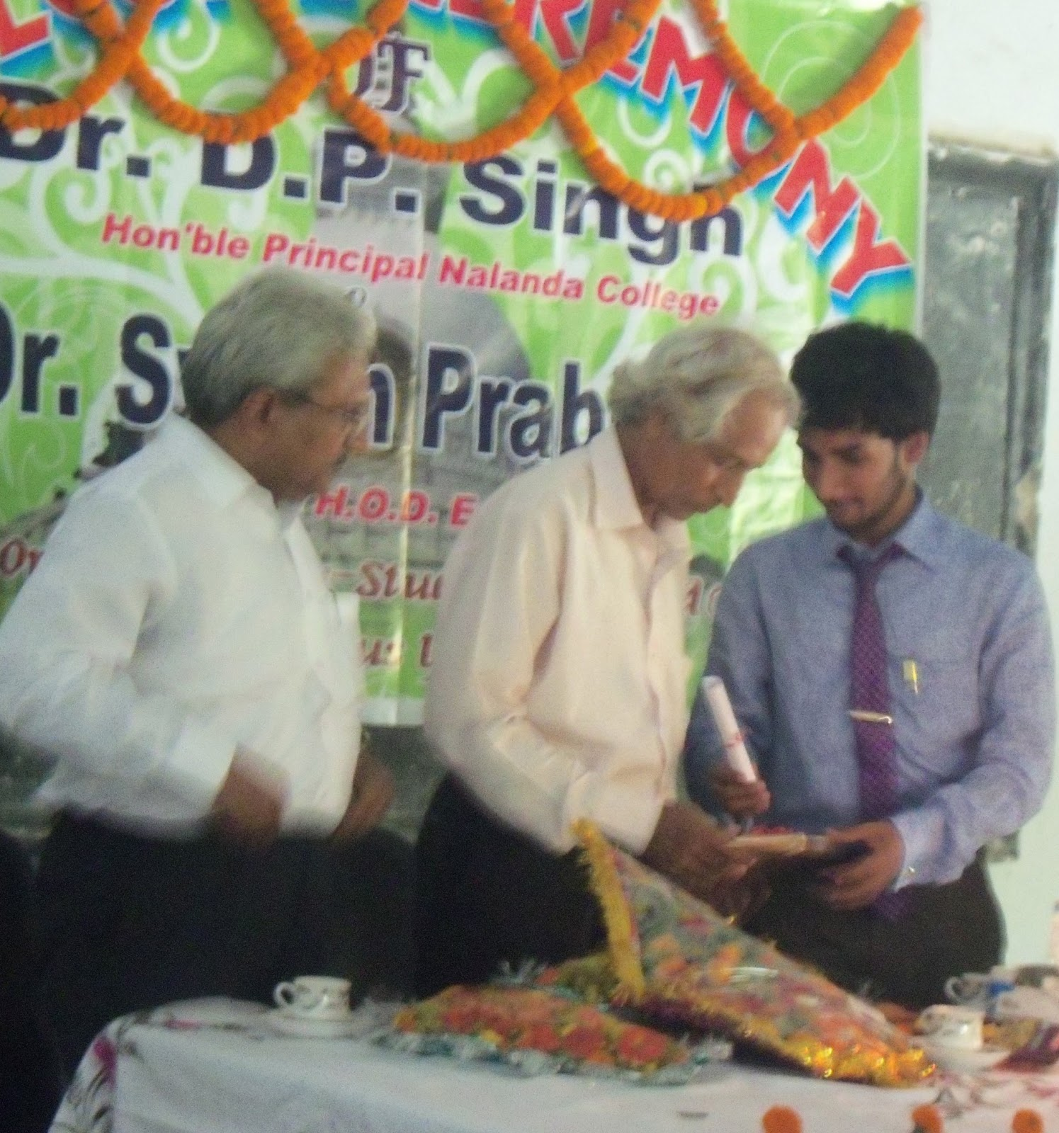 poet alok mishra poems and essays felicitation in nalanda dr d p singh in centre dr swarn prabhat in left and the author and poet alok mishra in right the poem folded