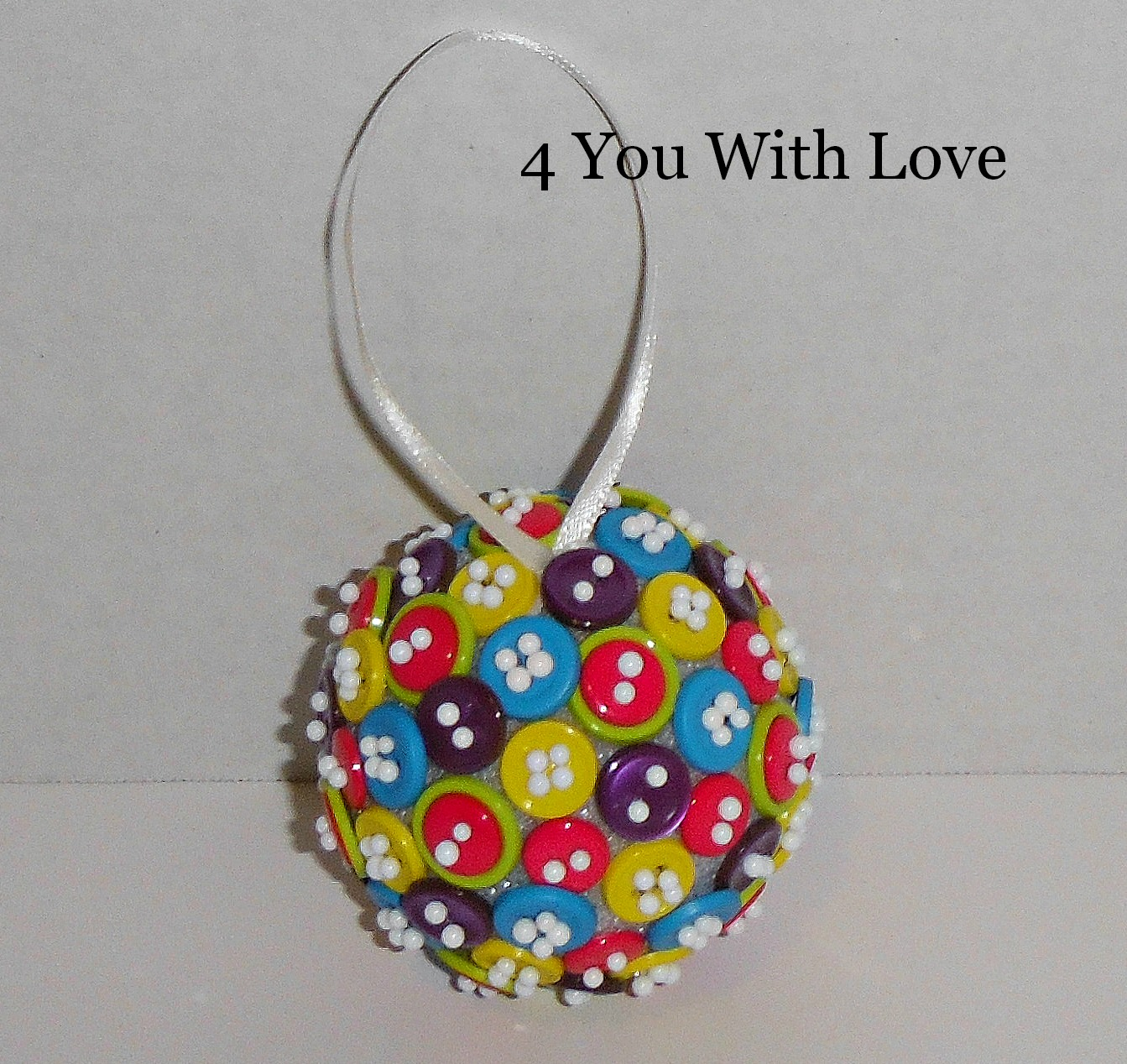 Homemade holiday inspiration day button ball ornament
