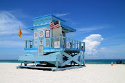 Miami's South Beach story (beautiful colorful scene of fancy lifeguard hut on north miami beach on sunny day)