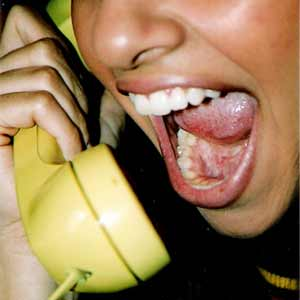 Person screaming into telephone