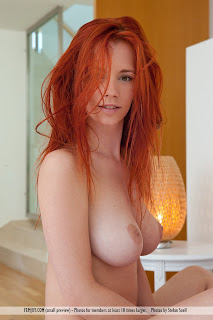 "Ariel - ""Pretty"" by Femjoy - nude redhead with messy hair and large natural breasts"