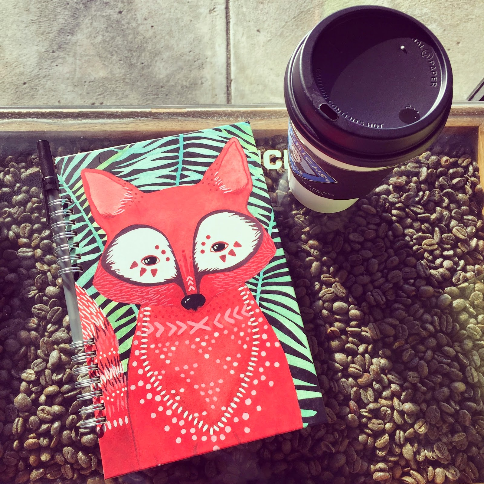 notebook and coffee at the cafe in spring