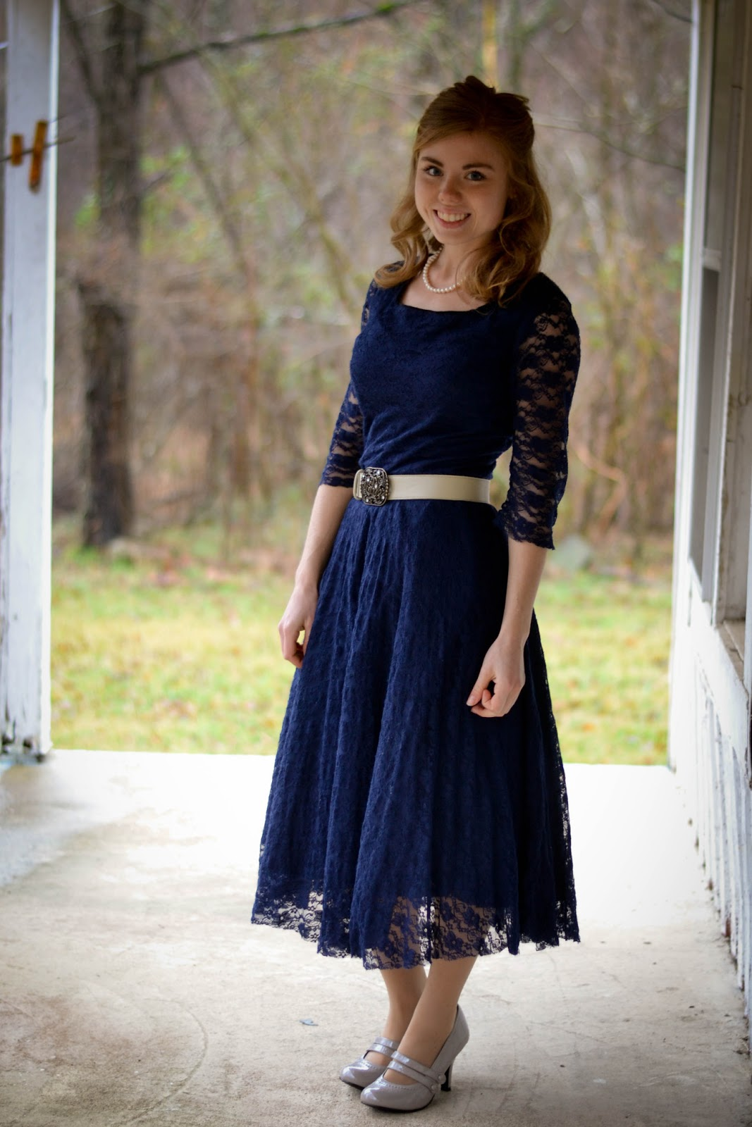Navy lace dress with square neckline sheer sleeves circle skirt