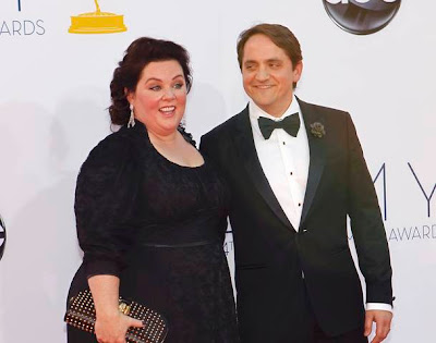 Actress Melissa McCarthy and husband Ben Falcone arrive at the 64th Primetime Emmy Awards in Los Angeles