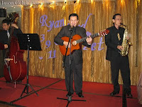 3 piece Wedding Live Band made up of guitarist / singer, saxophonist and double bassist