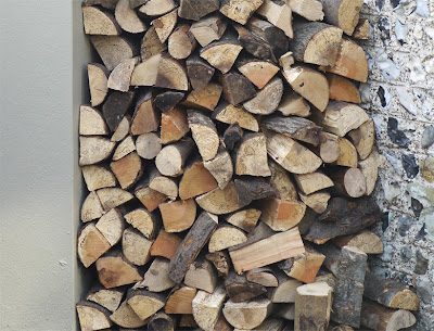 our woodstack wedged in exterior alcove