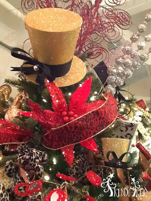 http://www.trendytree.com/raz-christmas-and-halloween-decor/raz-7-glitteredtop-hat-gold-silver-black-christmas-decoration.html