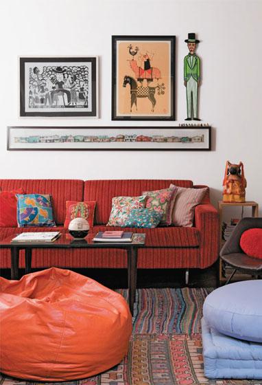 deste apartamento buscava aconchego Na decoração da sala, quadros